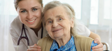 portrait of an old woman together with her caregiver