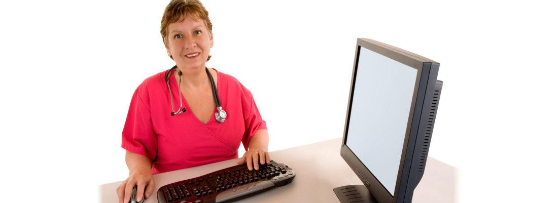 smiling nurse sitting at her desk